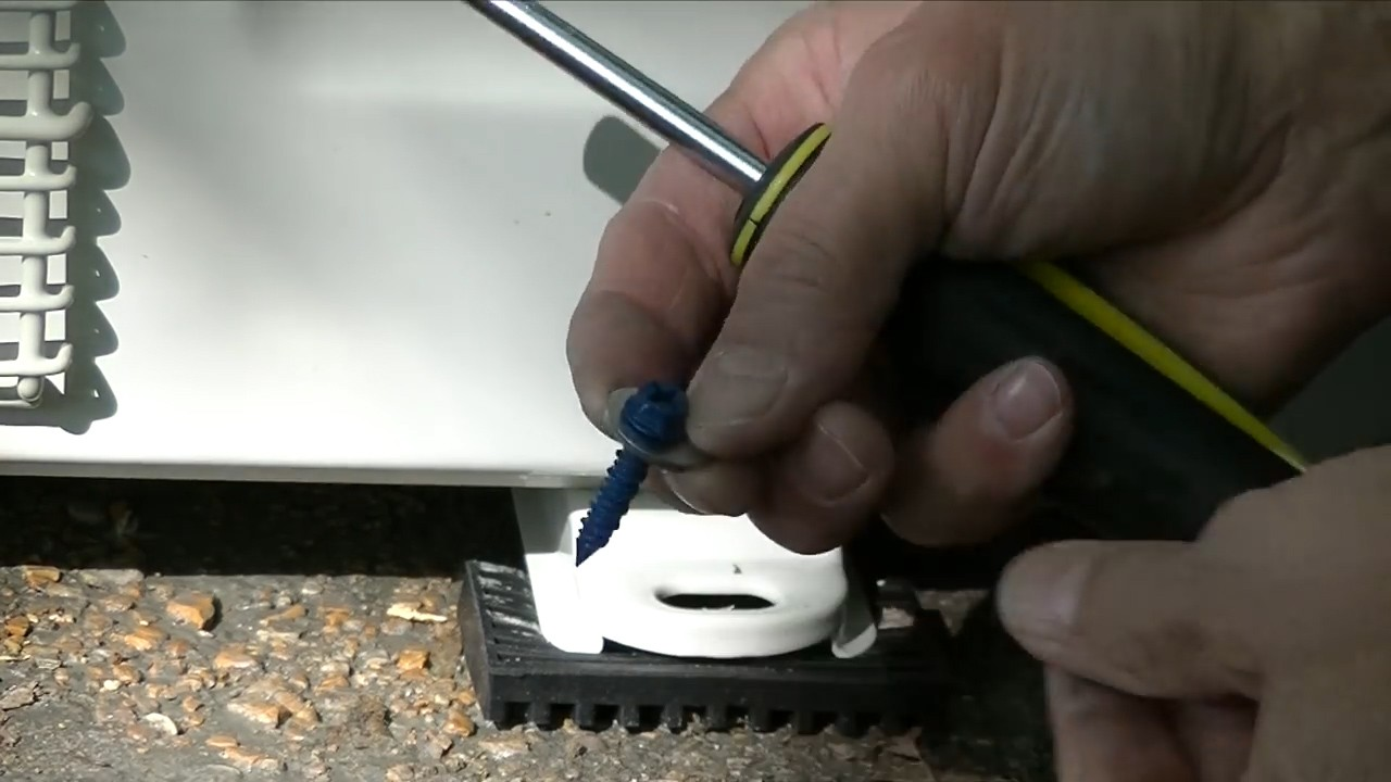 how to install a mrcool mini-split: anchor the condenser in place part  2