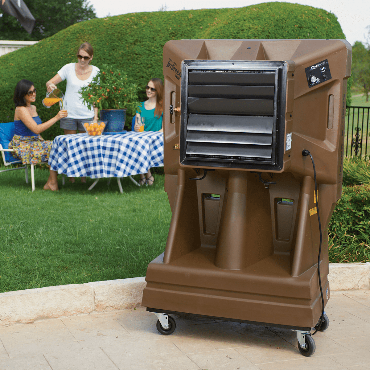 concert events midsized evaporative cooler blowing across a lawn where people are enjoying a lunch